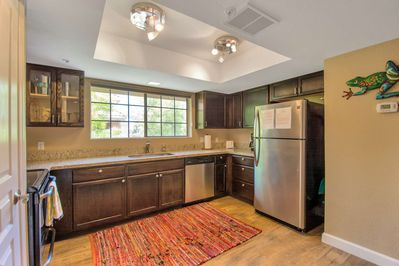 Enjoy the Kitchen with fridge, dishwasher, microwave, flat top stove