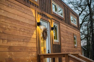 This elegant tiny house is clad in hand-made Shou Sugi Ban cedar siding.