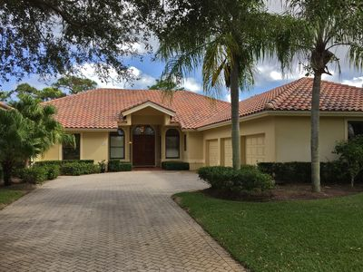 Front of house with 2 car garage (set 25 ft. from road) in Hobe Sound Golf Club