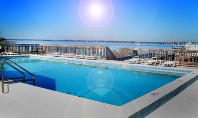 Take a dip in your beautiful pool overlooking the Sound and your private beach!