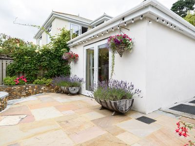 Photo for Lovely holiday home with unique and beautifully landscaped paved garden.