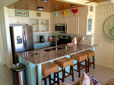 Relax and cook in a brand new coastal kitchen--new cabinets, new appliances, etc