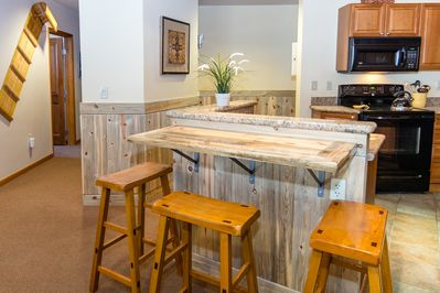 Additional breakfast bar seating for three