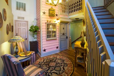 Entrance to 2nd floor suite resembling a historic Charleston house facade.