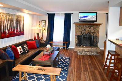 Living room with flat screen TV and futon sleeper
