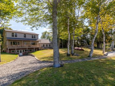 Photo for Dog-friendly lakefront home w/ free WiFi, pebbly beach, great location near town
