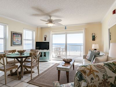 Photo for Gulf front corner condo! Amazing views! Steps to beach! Heated outdoor pool!