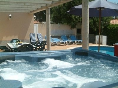 pool terrace and 6 person hot tub jacuzzi