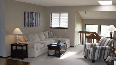 The living room is a comfortable space for working or relaxing.