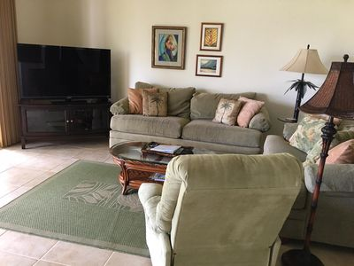 Comfortable living area over looking the golf course and distant ocean views.