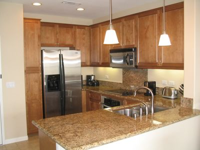 Sparkling Bright Kitchen with tile floors. Coffee maker and Espresso machine.