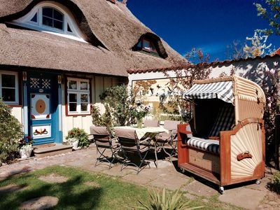 Photo for Idyllic thatched house on the harbor in Prerow