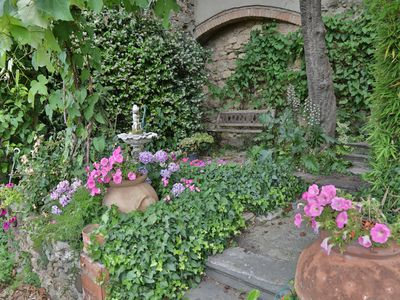 Photo for Charming house with garden in the historic center of Bibbona, with views