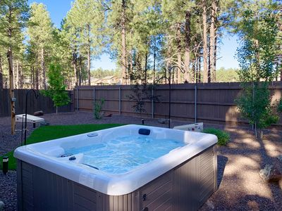 Private hot tub with adjustable lights and jets. Professionally maintained.