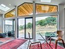 Entrance - Floor-to-ceiling windows provide expansive views of the lush property.