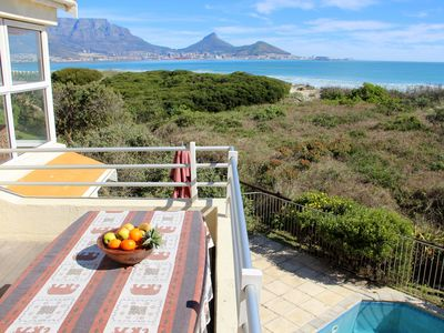 Photo for Right on the beach, overlooking Table Mountain, Swimming Pool, Security Complex