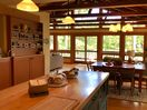Prepare meals in the Fully Equipped Kitchen-opens to dining and deck.