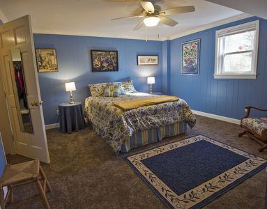 Bedroom with queen bed and walk-in closet, ceiling fan