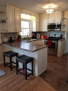 Beautifully renovated kitchen, which opens to dining room