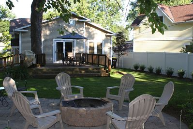 Backyard with deck, patio and built-in firepit. Plenty of seating for everyone!