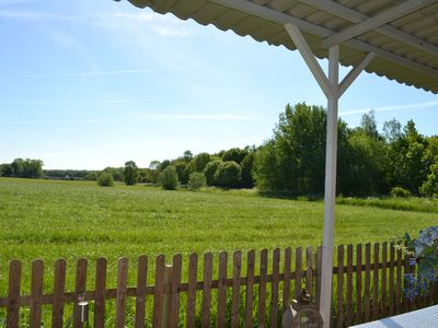Photo for B & B Boszicht Leeuwarden Veranda with a rural view of the adjacent city forest