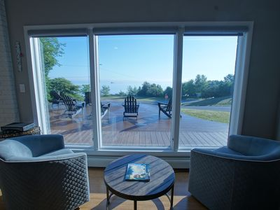 Photo for Enjoy cool breezes, take in lake and island views from this updated modern home.