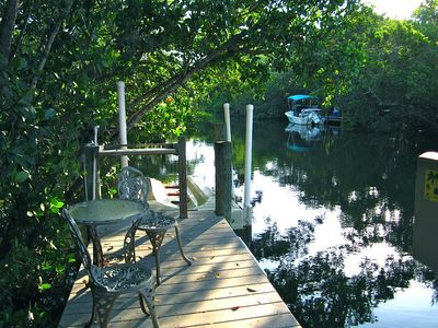 The dock is a tranquil spot for bird-watching and manatee sightings.