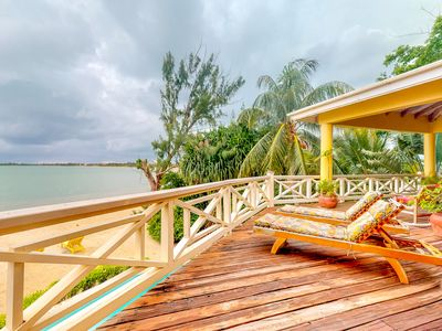 Photo for Beachfront apartment w/ great views, shared pool & water sport gear