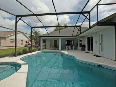 Photo for 4 BR / 3 BA orlando vacation pool home in Clermont, BBQ Grill, Free Wifi!!