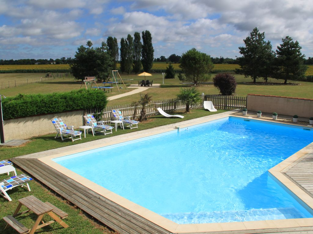 6 farm with heated outdoor swimming pool homeaway for Heated garden swimming pools