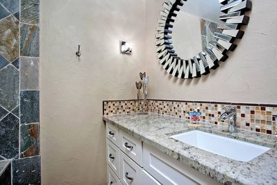 GUEST BATHROOM WITH DEEP SOAKING TUB, GRANITE COUNTERS AND SLATE