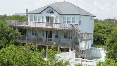 Photo for Secluded ocean-side getaway. Private pool and new hot tub. Blocks from the beach