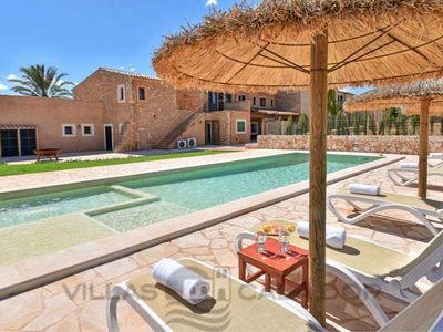 Photo for 6 bedroom Villa, sleeps 12 in Portopetro with Pool, Air Con and WiFi