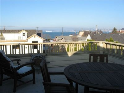 Rooftop deck with view of the Sound and ferries