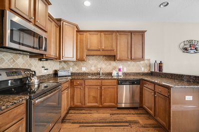 Kitchen - The kitchen has beautiful granite countertops with stainless steel appliances.