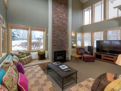Photo for Bright 3-bedroom condo on Warm Spring Creek with mountain vista views steps from ski lifts.
