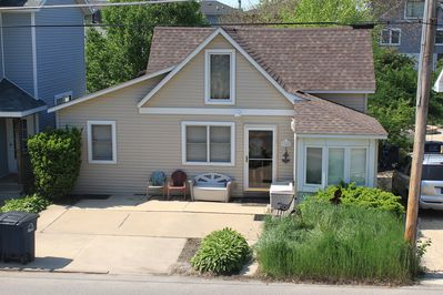 Front of home with two dedicated parking spots.