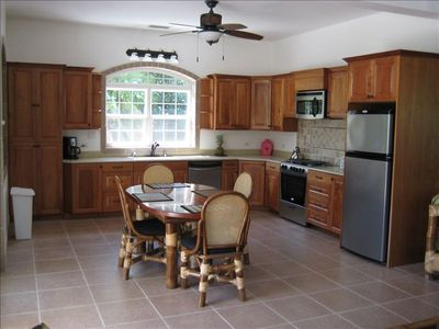 Large kitchen with all amenities, cooking ware, teflon coated pans, etc.