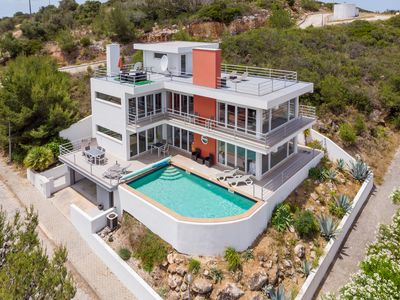 Photo for Stunning 3 bedroom 'glass' villa with panoramic views & infinity pool