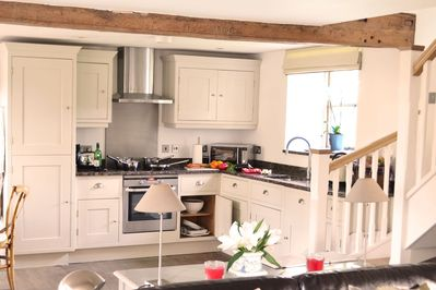 Ground floor: Kitchen area in the open plan living space with exposed beams