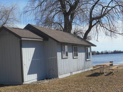 Cabin 3 on the shore of Lake George shows the willow tree and lake  in front