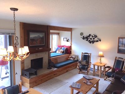Living room with bay window bunk bed/reading nook