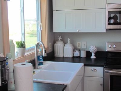Double sink with designer faucet