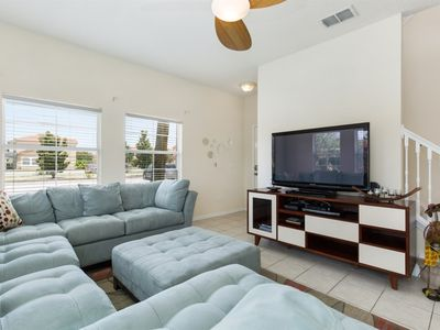 Photo for 4 bedroom 3 bath villa vacation home awaits you with Resort Perks and minutes from Disney!