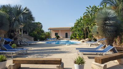 Photo for 3 apartments and 1 villa with large park pool with tropical plants Ravanea