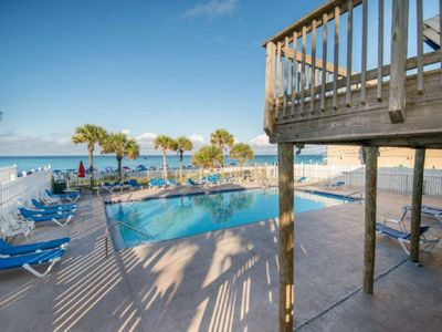 Photo for Easy walk to the beach! Colorful cozy cottage. Tons of amenities. Free WiFi. Tickets to Gulf World!