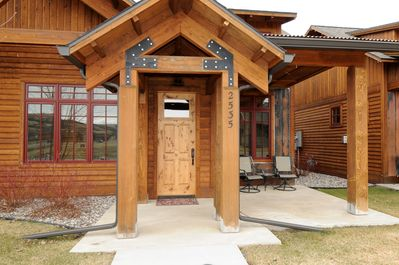 Front entrance to the Bridger Bungalow with a nice patio and barbecue grill.