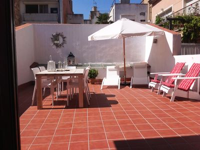 Photo for Five person apartment with private terrace of 40m2, 150 meters from the beach and sea