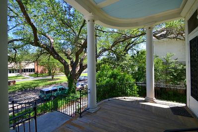 The main porch that is supported by stately columns overlooking the Avenue & oak
