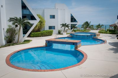 Backyard swimming pool with ocean view and private beach area for our OHM guests